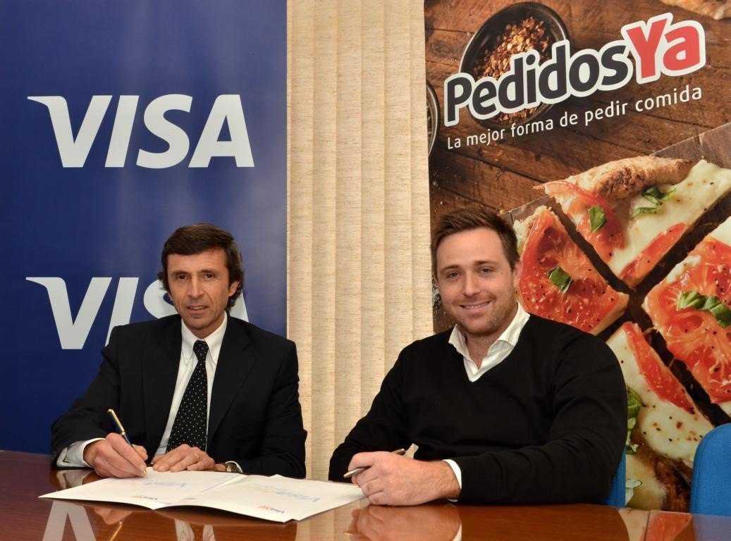 Gerente General de Visanet Uruguay, Cr. Sergio J. Cestau, y CEO y Co-Fundador de PedidosYa, Ariel Burschtin
